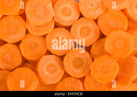 Chopped carrot background close up full frame. - Stock Image
