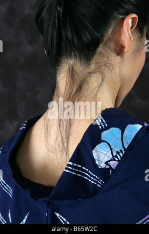 Neck of a Japanese Woman in a Blue Kimono - Stock Image