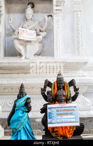 Signs on Hindu Deities Soliciting Funds for Temple Refurbushment, Hindu Sri Maha Muneswarar Temple, Kuala Lumpur, Malaysia. - Stock Image