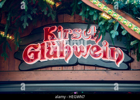 KIrsch gluwein sign on a Christmas market stall in Trier - Stock Image