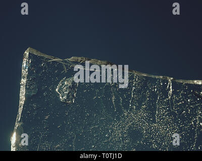 Ice board with cracks and bubbles. Natural flat ice piece - Stock Image