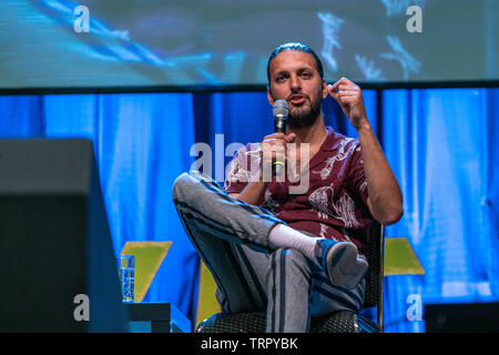 Bonn, Germany - June 8 2019: Shazad Latif (*1988, British actor - Star Trek: Discovery) talks about his experiences in Star Trek Discovery at FedCon 28 - Stock Image