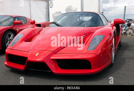 Front view of a red, Ferrari Enzo on display at the Ferrari Club Zone of the Silverstone Classic 2017 - Stock Image