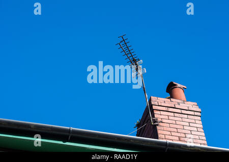 TV aerial on the chimney of a house in Manchester, England, UK - Stock Image
