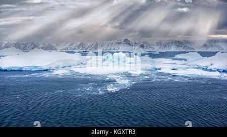 View of Snow Hill Island, Antarctica, from the sea, with icebergs and blue ice in the foreground. Beautiful sunlight - Stock Image