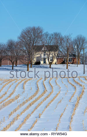 Farm farmhouse and barn in March with winter fields, on the Oak Ridges Moraine north of Oshawa Ontario Canada - Stock Image