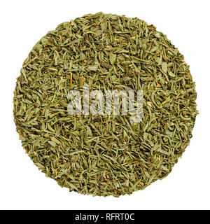 Dried savory. Herb circle from above isolated over white. Disc made of chopped summer savory, Satureja hortensis, a green herb and seasoning. - Stock Image