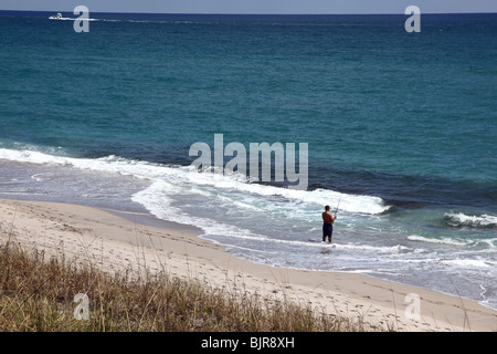 Lone man fishing in the distance, Palm Beach, FL, USA - Stock Image