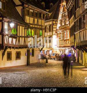 TYPICAL RESTAURANTS AND WINE TAVERNS AT LA PETITE FRANCE, NIGHT LIFE, STRASBOURG, ALSACE, FRANCE - Stock Image