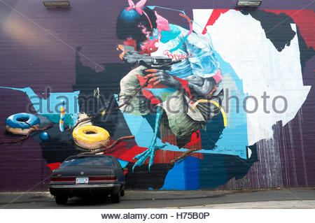 Large scale painted wall mural (and parked vehicle), in Portland, Oregon, USA. - Stock Image