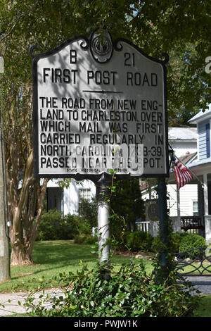 A historic marker showing where the First Post Road passed carrying mail from New England to Charleston. - Stock Image