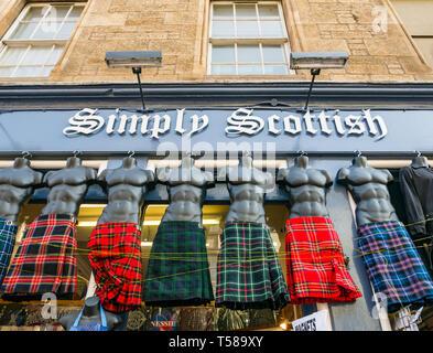 Souvenir shop selling tartan kilts with male torso model display, Simply Scottish, Royal Mile, Edinburgh, Scotland, UK - Stock Image