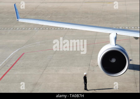 Shanghai, China-November 30, 2008:Guard on the runway to protect the airplane of unwanted visiters - Stock Image