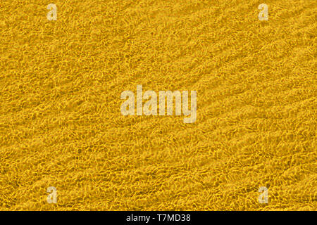 Yellow abstract waved surface close up. Texture and background - Stock Image
