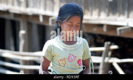 A young indigenous Wa girl in her village in Burma (Myanmar). - Stock Image