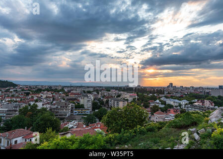 Warm summer sunset from Nebet tepe Hill in Plovdiv city, Bulgaria. Panoramic view. Ancient city is UNESCO's World Heritage. - Stock Image