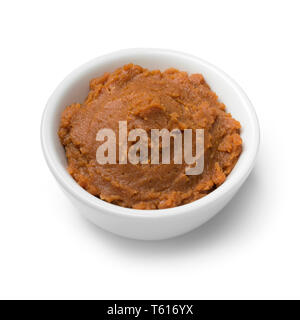 Bowl with Japanese miso paste as an ingredient isolated on white background - Stock Image
