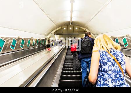 London underground escalator, underground escalator, using underground escalator, riding underground escalator, escalator, London underground - Stock Image