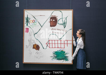 London, UK. 21st June, 2019. Sotheby's assistants with Big Snow, 1984, Acrylic and oilstick on canvas by Jean-Michel Basquiat. Estimate: £3,500,000-4,500,000 at the Sotheby's Contemporary Art Auction preview for the Evening sale on 26 June Credit: amer ghazzal/Alamy Live News - Stock Image