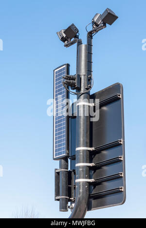 Close up detail of a solar powered pedestrian crossing sign - Stock Image