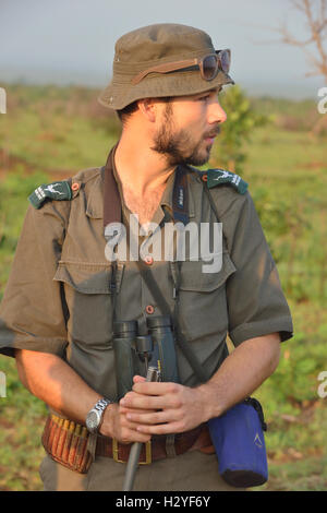 Ranger with group of walkers on a 5 am bushwalk (walk outside the electric fences of the camps) sight rhinos &wild - Stock Image