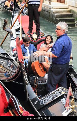 Musician and singer at Gondola Serenade Venice - Stock Image