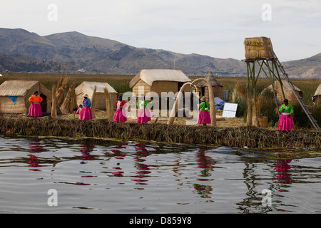 The Uros people of the Peruvian Lake Titicaca - Stock Image