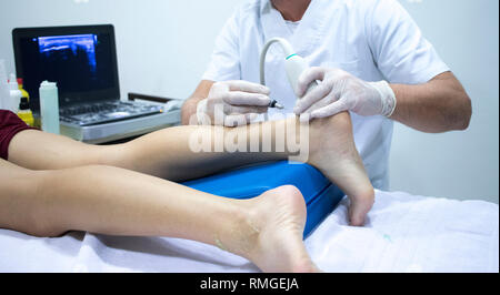 Physiotherapy clinic Intratissue Percutaneous Electrolysis EPI dry needling physiotherapist patient injury. - Stock Image