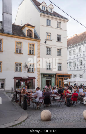 Kleines Cafe with outdoor seating in historic square, Vienna, Austria - Stock Image