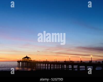 The Manhattan Beach pier at sunset. Manhattan Beach, California USA. - Stock Image