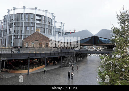 People shopping at Coal Drops Yard and Christmas tree in the Kings Cross redevelopment area of London UK  KATHY DEWITT - Stock Image