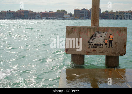 Graffiti close to Venice's Grand Canal protesting against cruise ships in the city. - Stock Image
