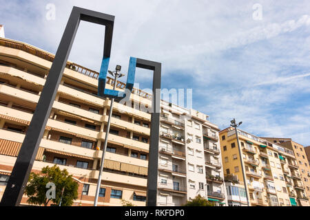 Malaga Spain, Public art with residential buildings behind, Andalucia, Spain. - Stock Image