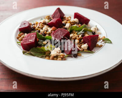 Lentil, beet salad with home made vegan feta - Stock Image