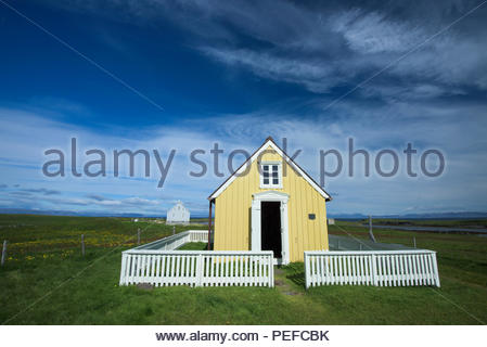 Houses on Flatey Island, the largest island of the western islands, located in Breidafjordur on the northwestern part of Iceland. - Stock Image