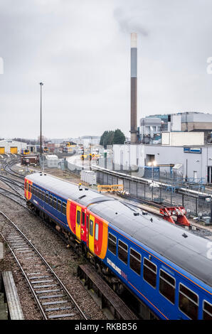 Train passing passing by an industrial area, Nottingham, England, UK - Stock Image
