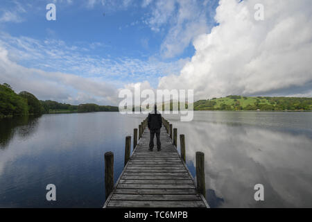 Coniston Water, Cumbria, UK, 6th June 2019. UK Weather.  Early morning sunshine for Coniston Water at the Lake district, heavy showers are forecast to return tomorrow. Credit Simon Maycock / Alamy Live News. - Stock Image