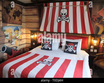 Adults double bed and décor in one of the Premium Pirate Rooms at the hotel at LEGOLAND Windsor Resort UK - Stock Image