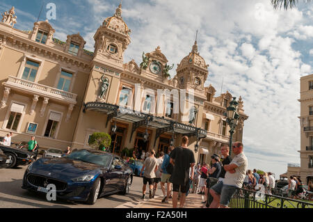 Casino de Monte-Carlo, with various supercars outside on summers day, Monaco, France. - Stock Image