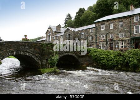 The Colwyn River, Bridge and Village at Beddgelert, Gwynedd, North Wales - Stock Image