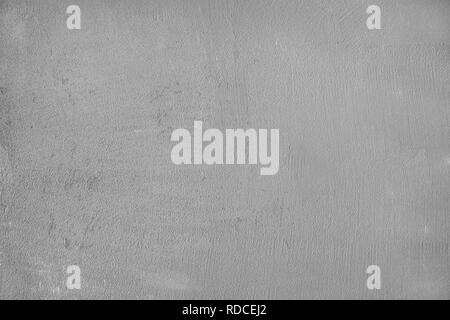 Raw gray plastered concrete beton wall as full frame background. - Stock Image