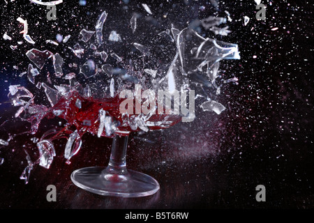 Glass of wine shattering - Stock Image