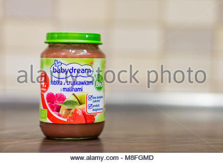 Polish Babydream baby dessert with apple, strawberry and raspberry in a glass jar - Stock Image