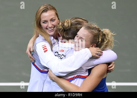 Prague, Czech Republic. 11th Nov, 2018. Czech tennis players L-R Petra Kvitova, Barbora Strycova and Katerina Siniakova celebrate after Siniakova's win against US tennis player Sofia Kenin (not seen) in the 2018 Fed Cup final match between Czech Republic and USA, rubber 3, singles, at the O2 arena in Prague, Czech Republic, on November 11, 2018. Czech team won the tennis Fed Cup after Siniakova defeated Kenin, thanks to which they defeated the USA 3-0 in the final match at the O2 arena in Prague, Czech Republic, on November 11, 2018. Credit: Michal Kamaryt/CTK Photo/Alamy Live News - Stock Image