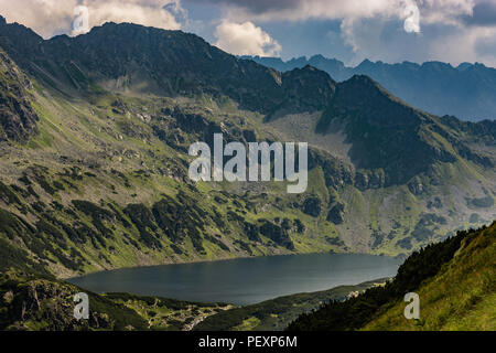 Great Polish Pond in Tatra Mountains, Lake in the Valley of the Five Polish Lakes - Stock Image