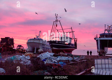 Hastings, East Sussex: Colourful dawn on the Stade fishermen's beach. Hastings has the largest beach-launched fishing fleet in Europe. - Stock Image