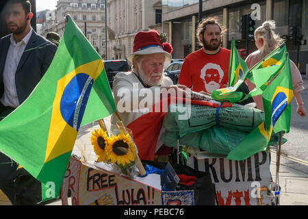 London, UK. 13th August 2018.  Scottish activist Harry McEachan supports the Brazilian protest outside the Brazilian embassy calling for the release of Luiz Inacio Lula da Silva, a former trade union leader who was President of Brazil from 2003-11 to enable him to stand for election again in October. Credit: Peter Marshall/Alamy Live News - Stock Image