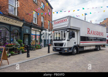 A delivery truck from Ramsdens a specialist supplier for florists, delivering to Oasis Florists in Kirkgate Ripon Yorkshire - Stock Image