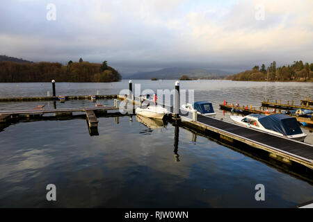 Small pleasure boats moored at a jetty, Bowness on Windermere, Lake District, Cumbria, England - Stock Image
