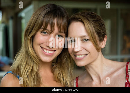 Mother and daughter cheek to cheek, portrait - Stock Image